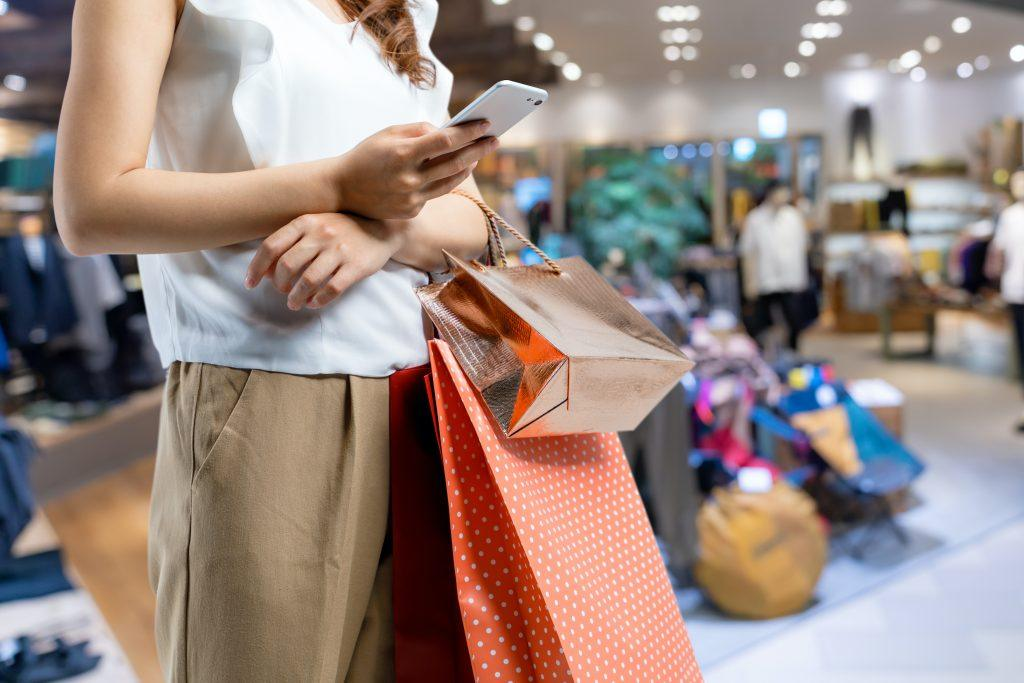 Female shopper searching for product on mobile social media apps
