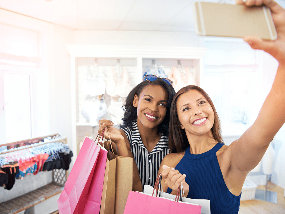 Shoppers taking social selfie in a store
